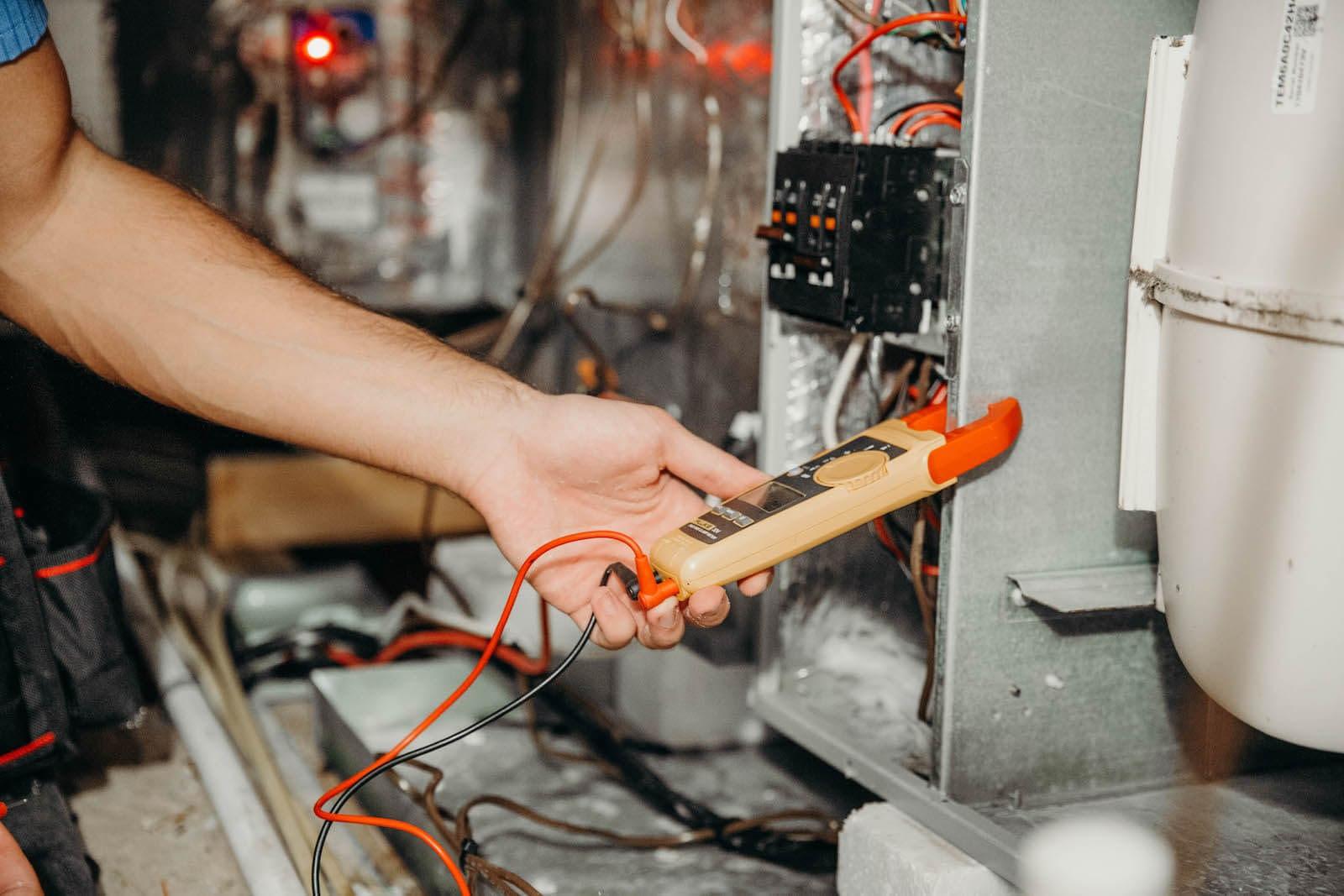 hvac technician doing furnace maintenance