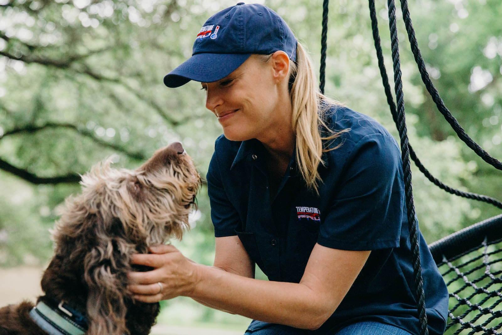 hvac technician with dog