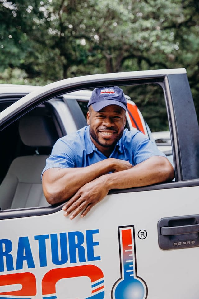 hvac technician in service vehicle